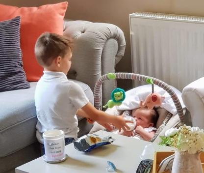 William feeding Violet